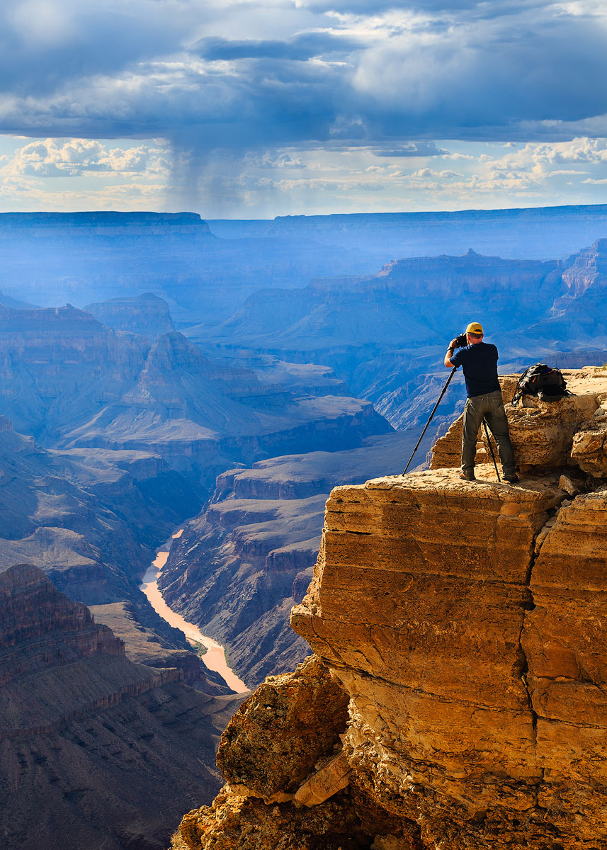 Setting up the shot at Mohave Point on the South Rim of the Grand Canyon. That's the Colorado River over 5,000 feet below. Photo...
