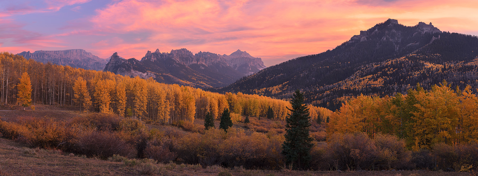 A panoramic view of a colorful sunset over the Big Blue Wilderness of the San Juan Mountains in southwestern Colorado. © Adam...