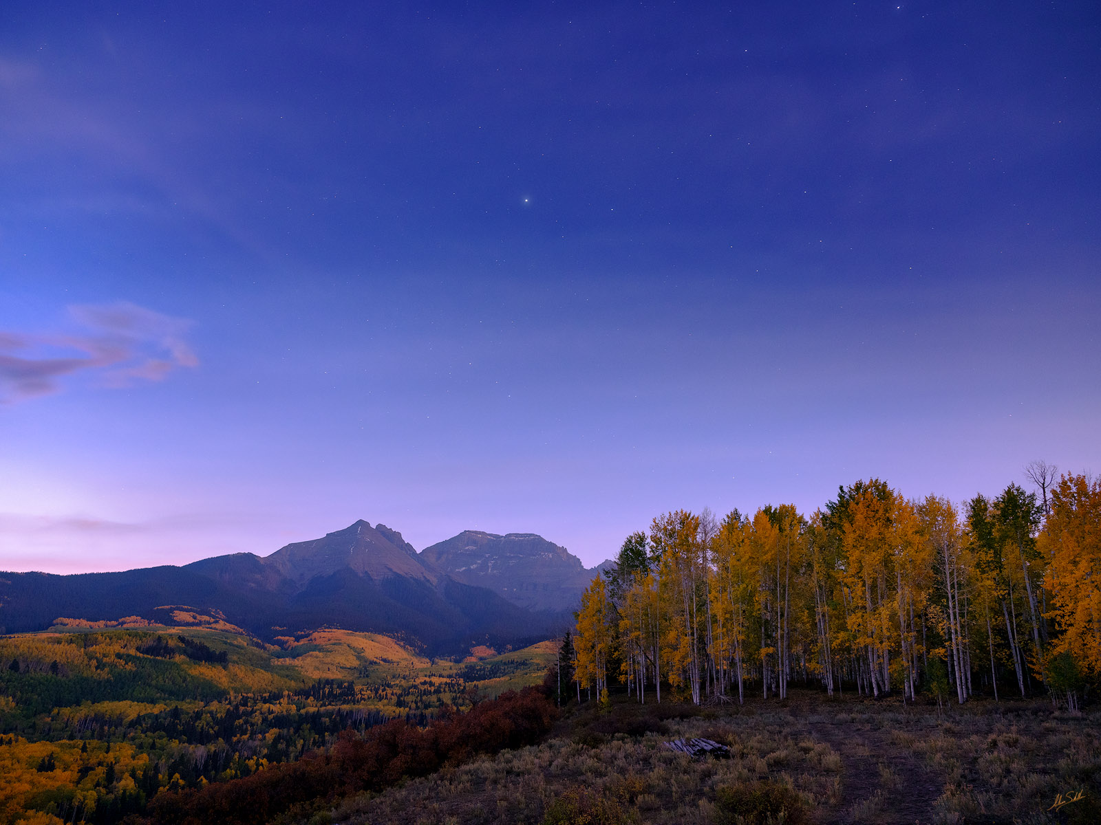 The stars in the night sky over the San Juan Mountains near Ridgway, Colorado, begin to give way to the faint light of dawn. ©...