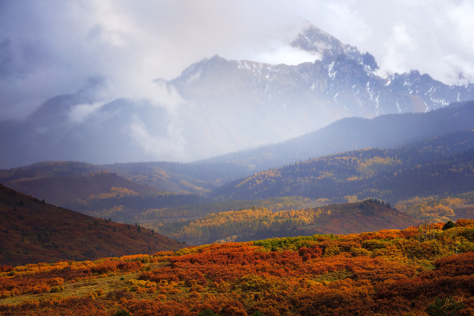 Mount Sneffels rises through the mist of a clearing storm. San Juan Mountains of Colorado near Telluride and Ouray. Photo ©...