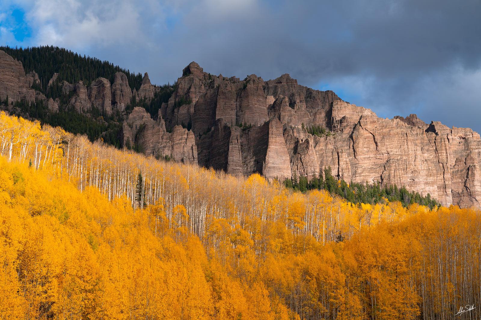 Brilliant fall color below the pinnacles overlooking Silver Jack Reservoir in the San Juan Mountains of Colorado. © Adam Schallau...