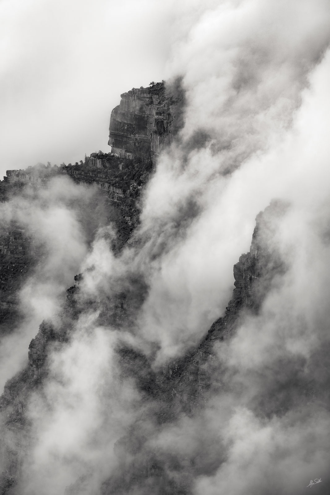 Clouds form within the depths of Grand Canyon. From Point Imperial on the North Rim. Photo © Adam Schallau, All Rights Reserved...