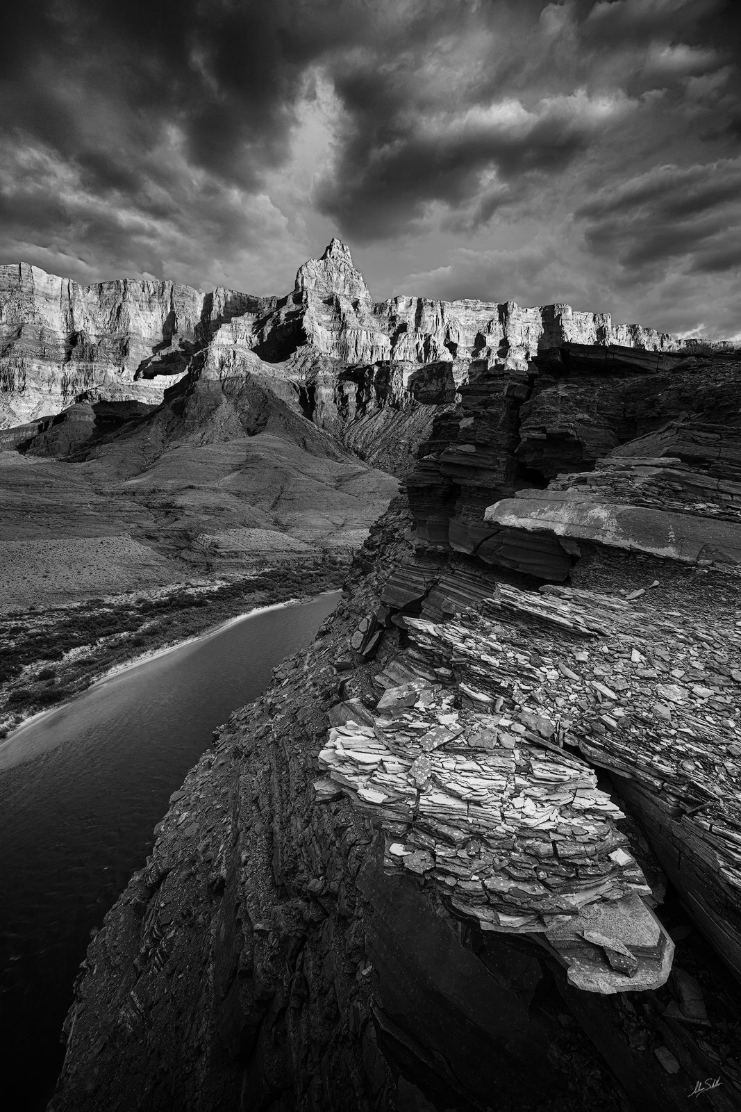Comanche Point rises high above the Colorado River in Grand Canyon. From the Dox Cliffs near river mile 68 in Grand Canyon National...