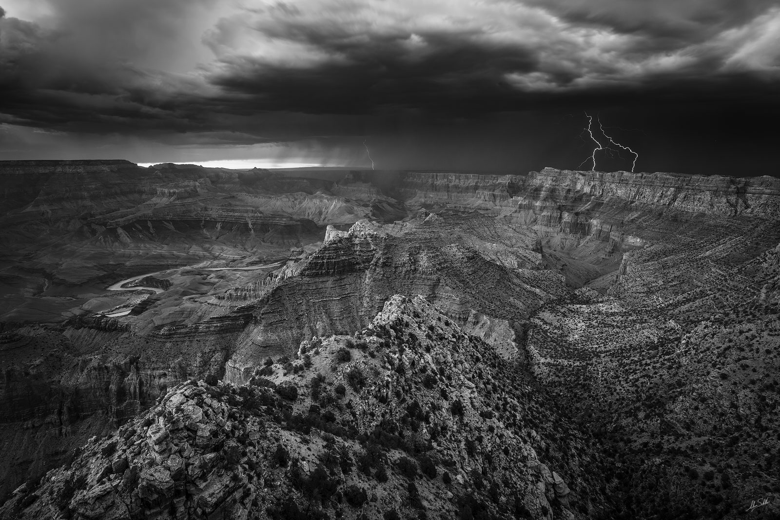 Lightning strikes the Painted Desert near the East Rim of the Grand Canyon. From Lipan Point on the South Rim of Grand Canyon...