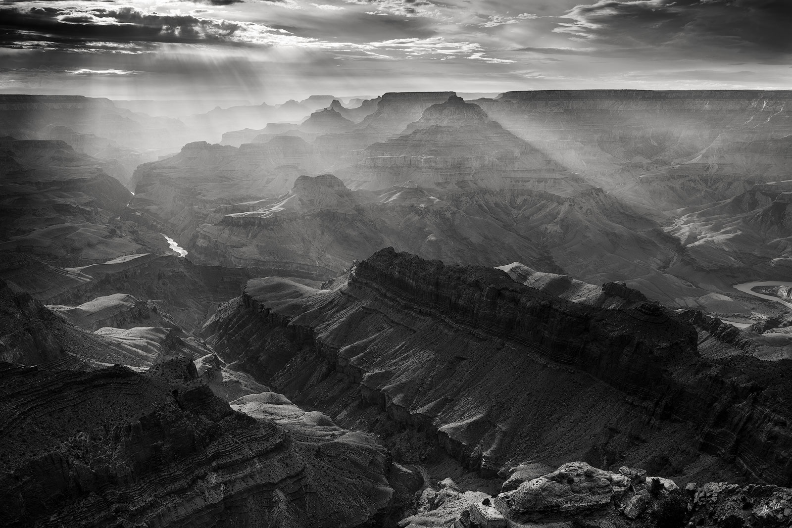 God beams stream through the Grand Canyon. From Lipan Point on the South Rim. Photo © Adam Schallau, All Rights Reserved.