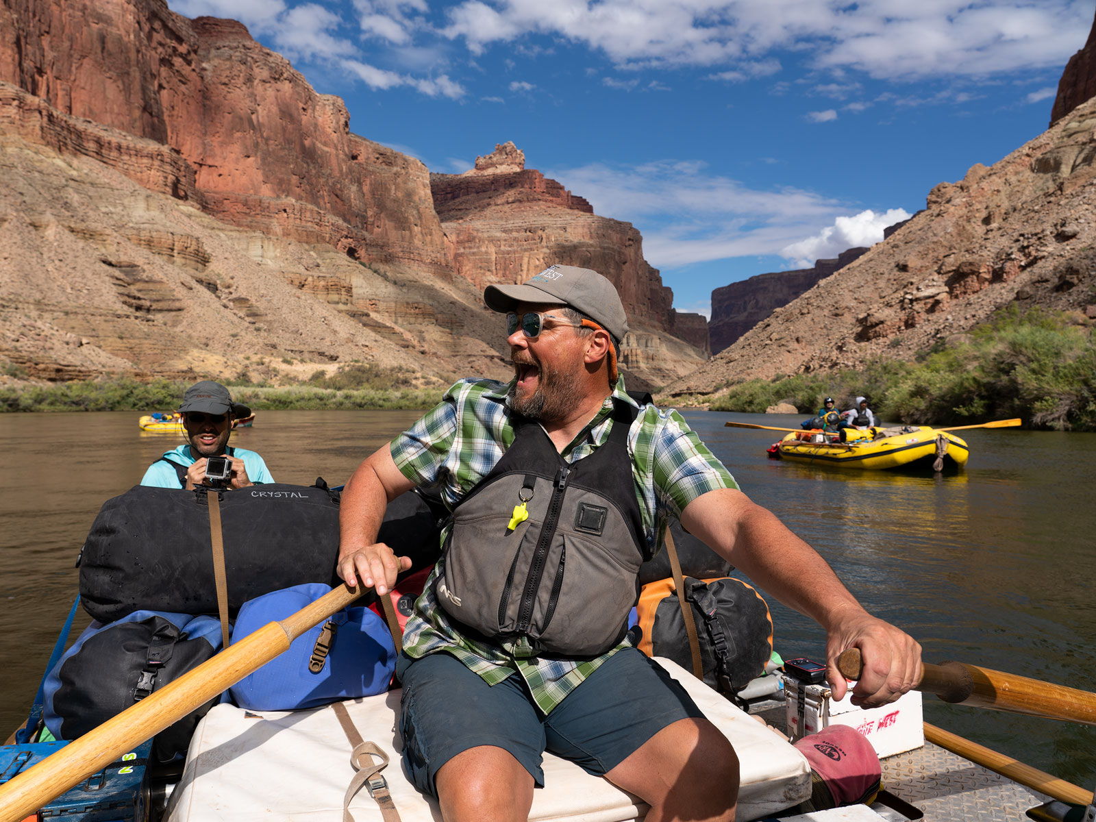 """Colorado river boatman John """"Bugs"""" Buggenhagen is having a great time chatting with his passengers as they float the Colorado..."""