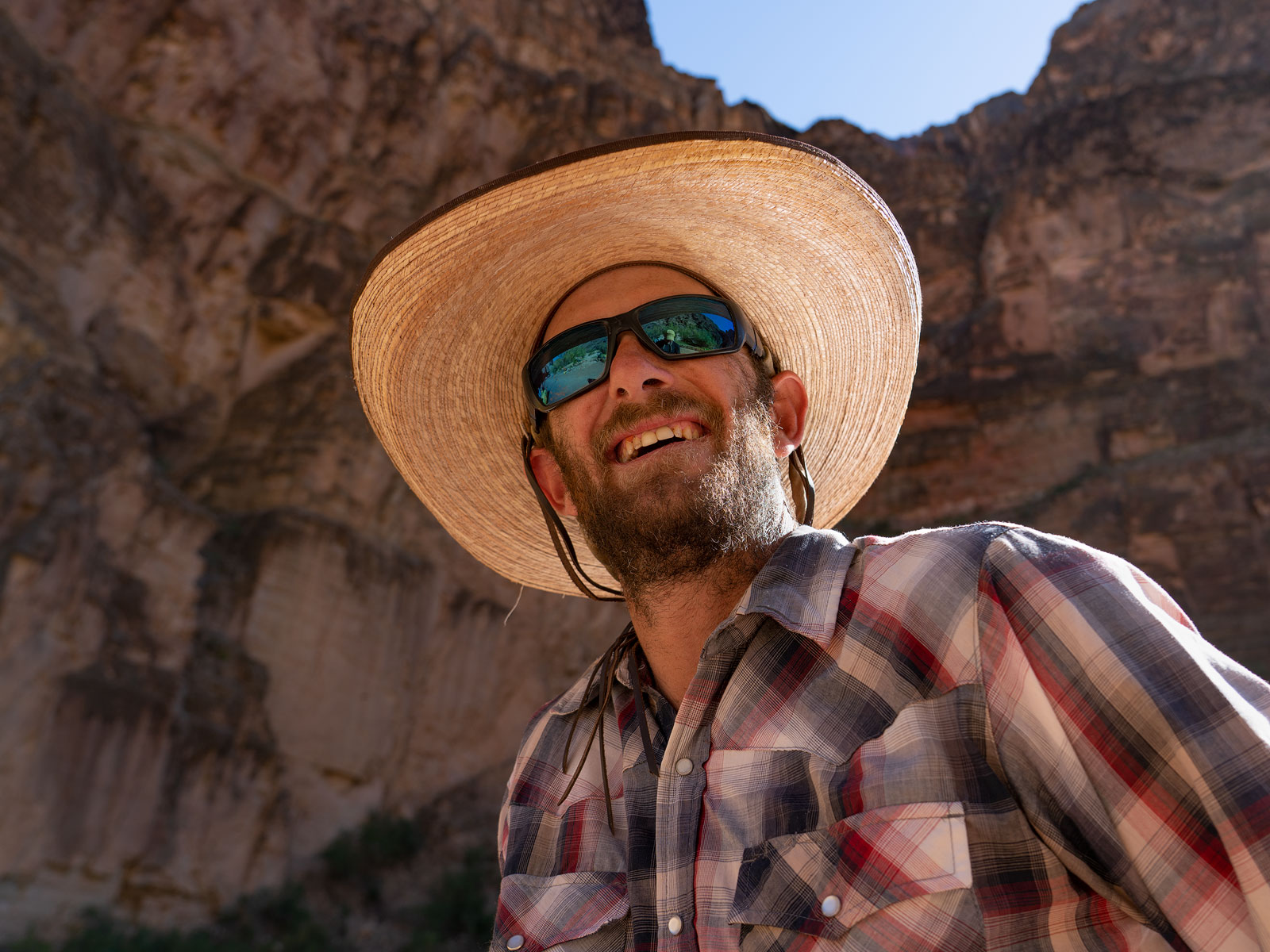 Boatman Patrick Clark smiles after a successful run of Lava Falls Rapid on the Colorado River in Grand Canyon National Park. ©...