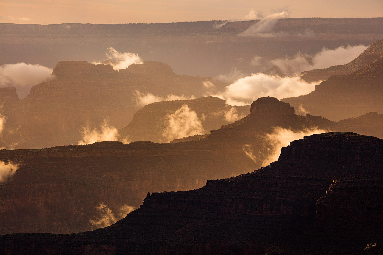 Clouds appear to rip and tear from the seemingly endless sea of ridges within the Grand Canyon following a rain storm. From Yavapai...