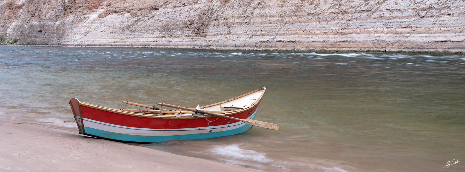 The South Fork, a wooden dory, tied to the beach at Shinumo Wash in Marble Canyon. Along the Colorado River in Grand Canyon National...