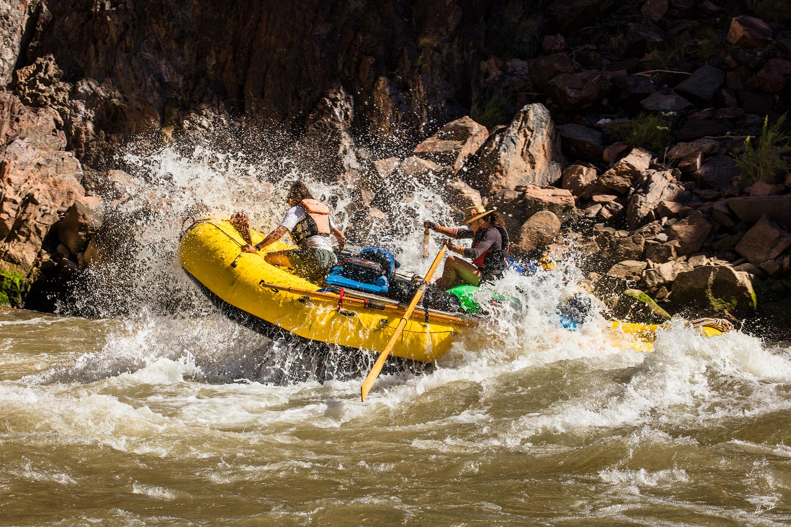 Rafters making the run through Specter Rapids (river mile 130) on the Colorado River. Grand Canyon National Park in Arizona....