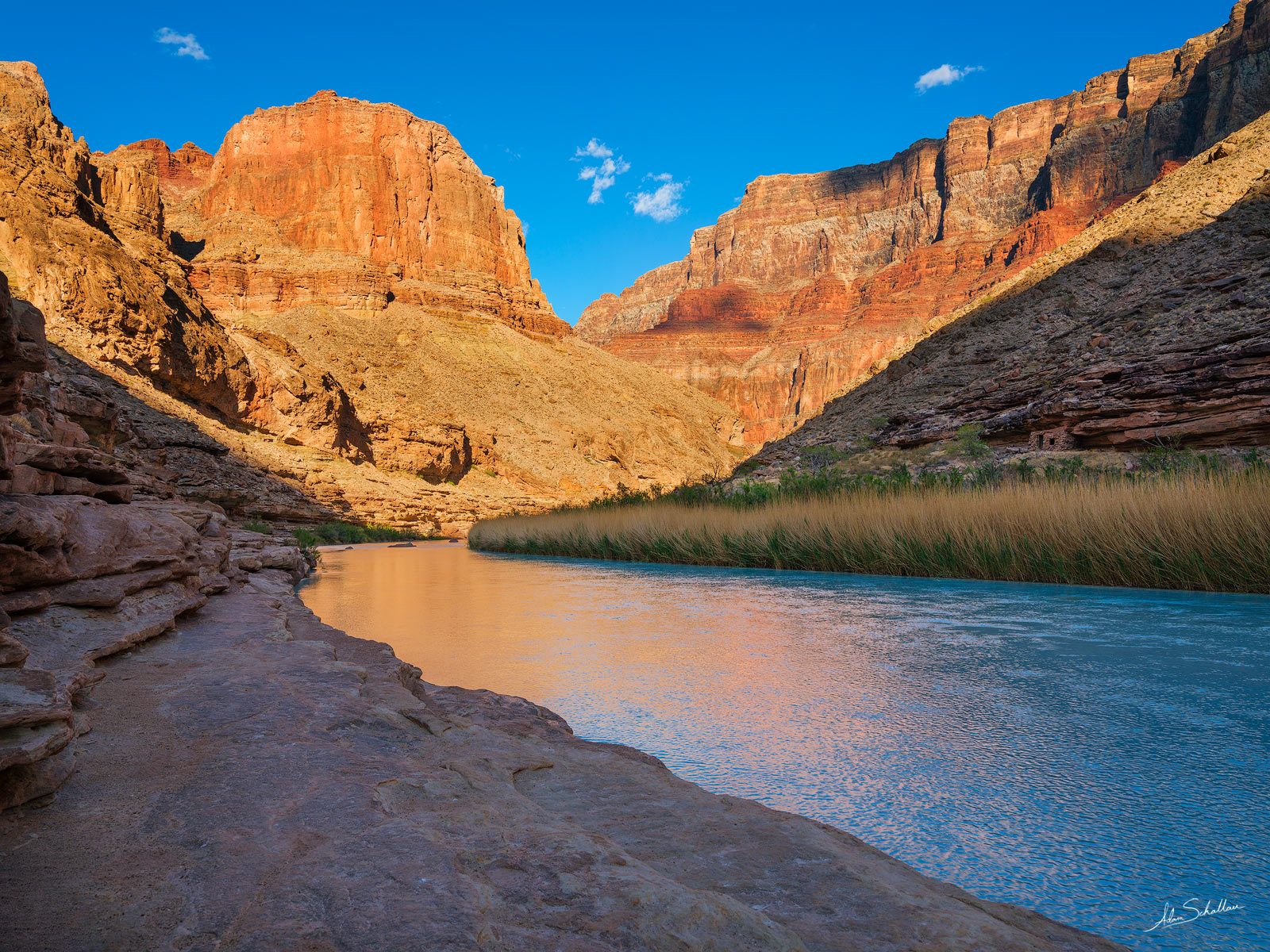 The cliffs surrounding the Little Colorado River begin to glow in late afternoon light. Across thr river is Beamer's Cabin. The...