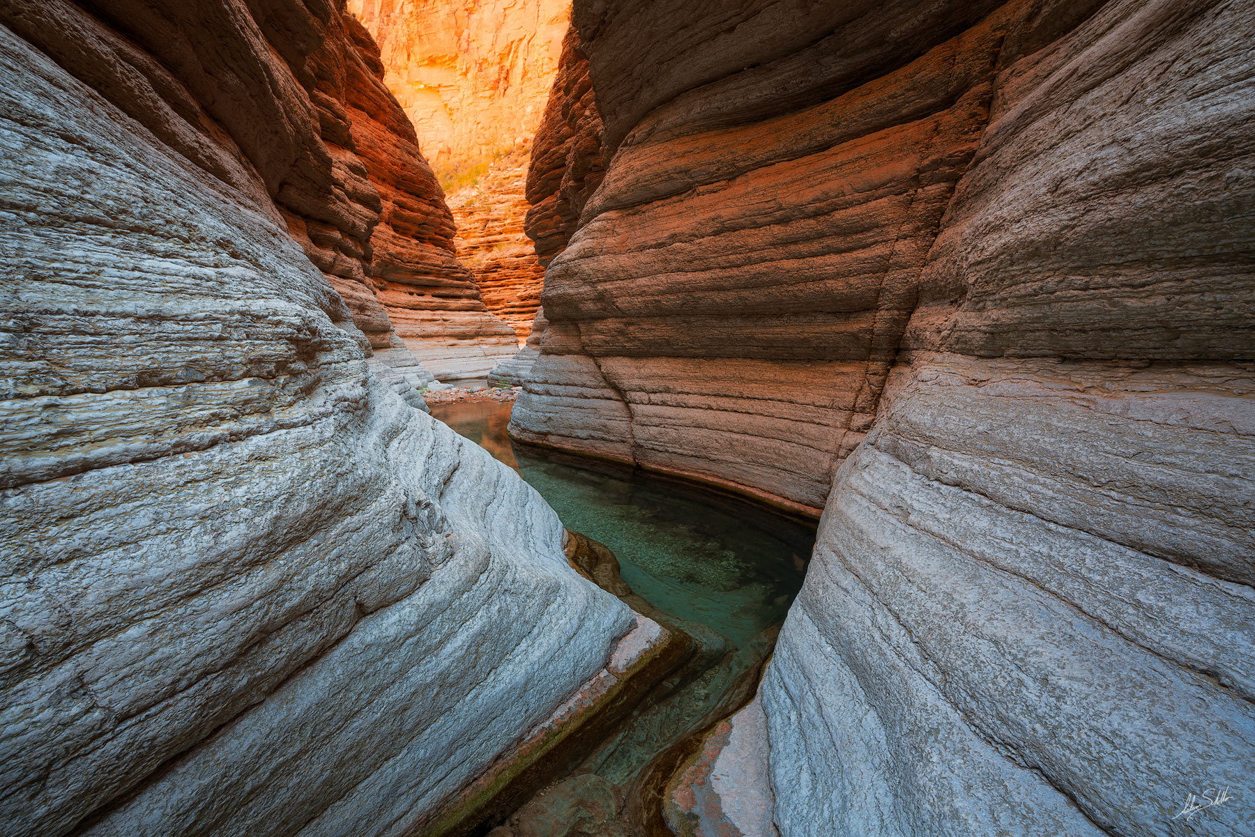 Water flows through a slot canyon. From Matkatamiba Canyon in Grand Canyon National Park in Arizona. Photo © Adam Schallau...