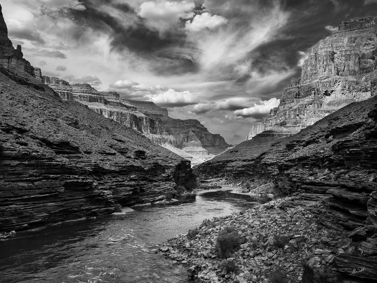 A black and white photograph of the Colorado River from a ledge high above Randys Rock camp in the Grand Canyon.