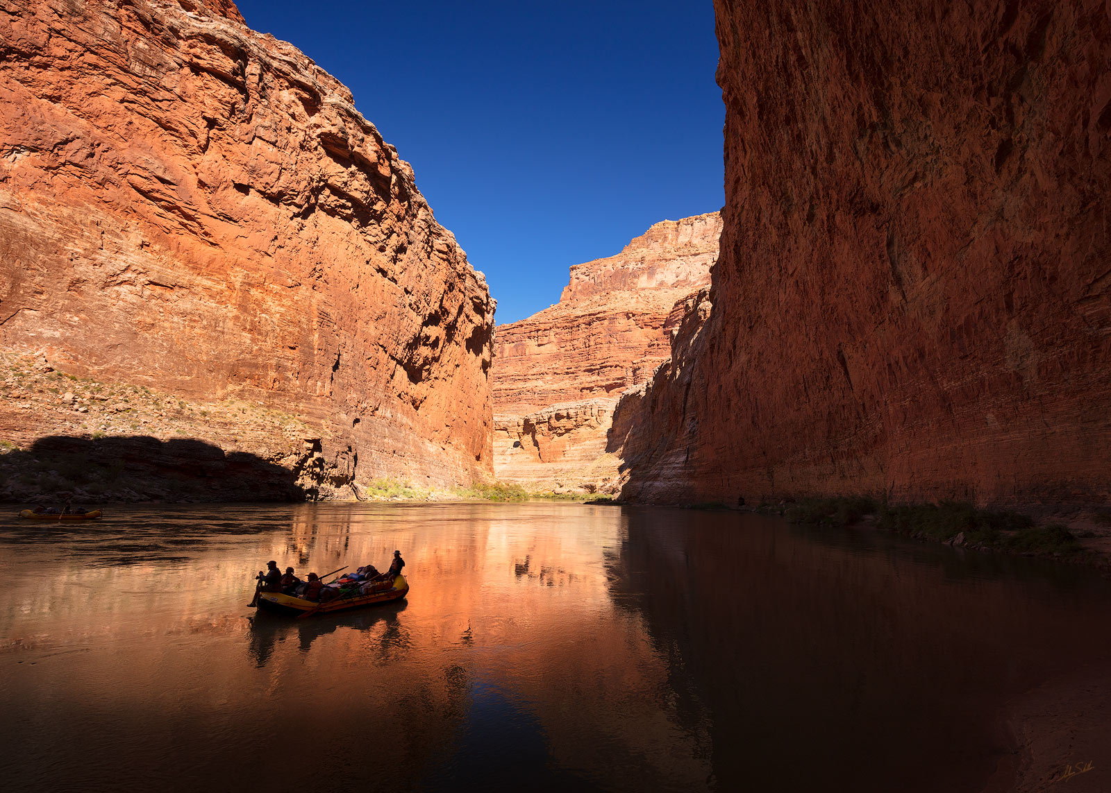 A peaceful moment floating the Colorado River in Marble Canyon. Grand Canyon National Park in Arizona. Photo © Adam Schallau...
