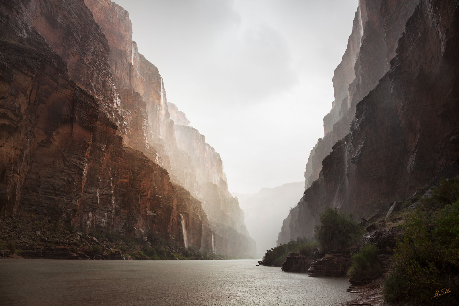 A sudden downpour from a monsoon thunderstorm has caused numerous waterfalls to cascade into Grand Canyon. Near river mile 164...