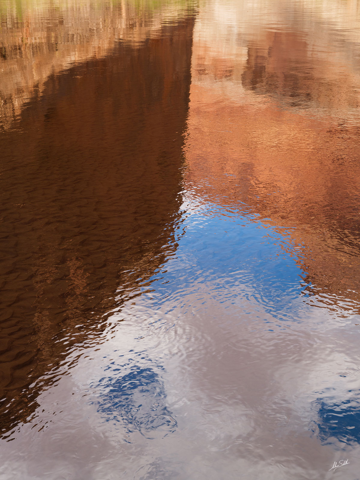 The cliffs of Marble Canyon reflect in the Colorado River. From Redwall Cavern in Grand Canyon National Park.