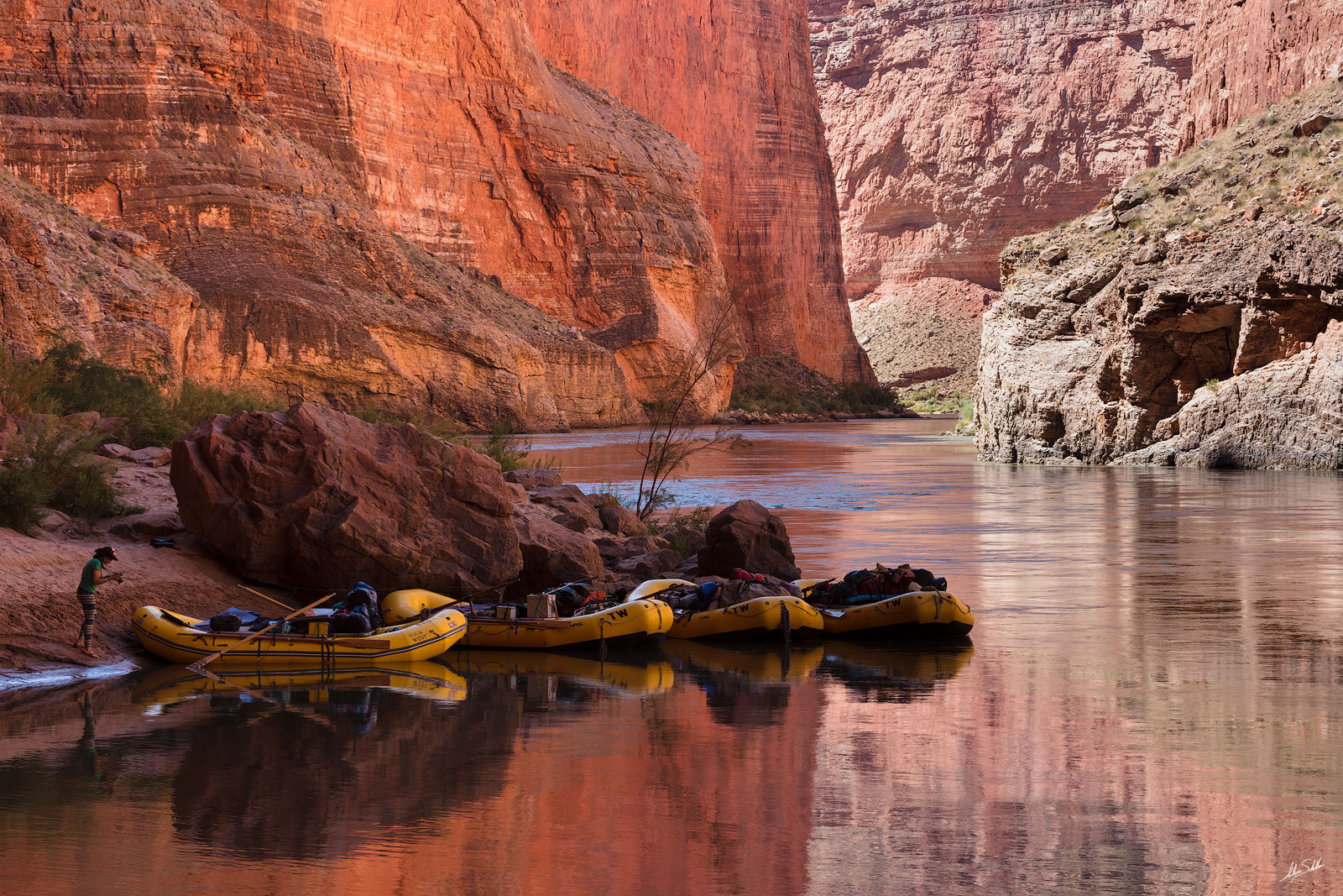 Rafts are tied-up at Redwall Cavern. Photo © Adam Schallau, All Rights Reserved.