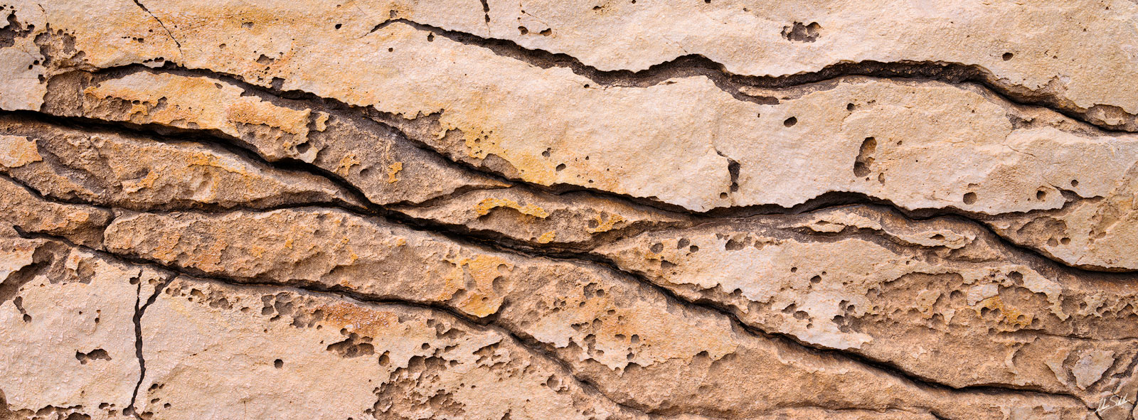 Details of cracks in a boulder along the Colorado River near South Canyon in Grand Canyon National Park. © Adam Schallau, All...