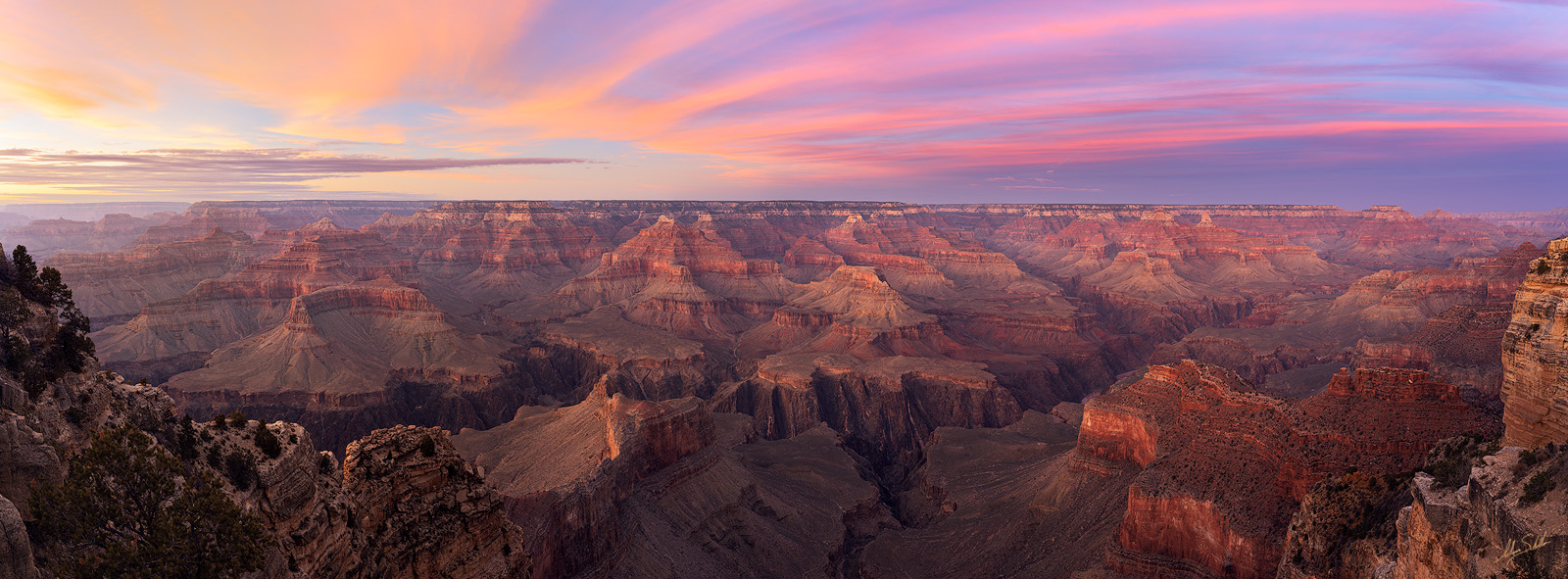 A panoramic sunset over the Grand Canyon. From Hopi Point on the south rim of Grand Canyon National Park. © Adam Schallau, All...