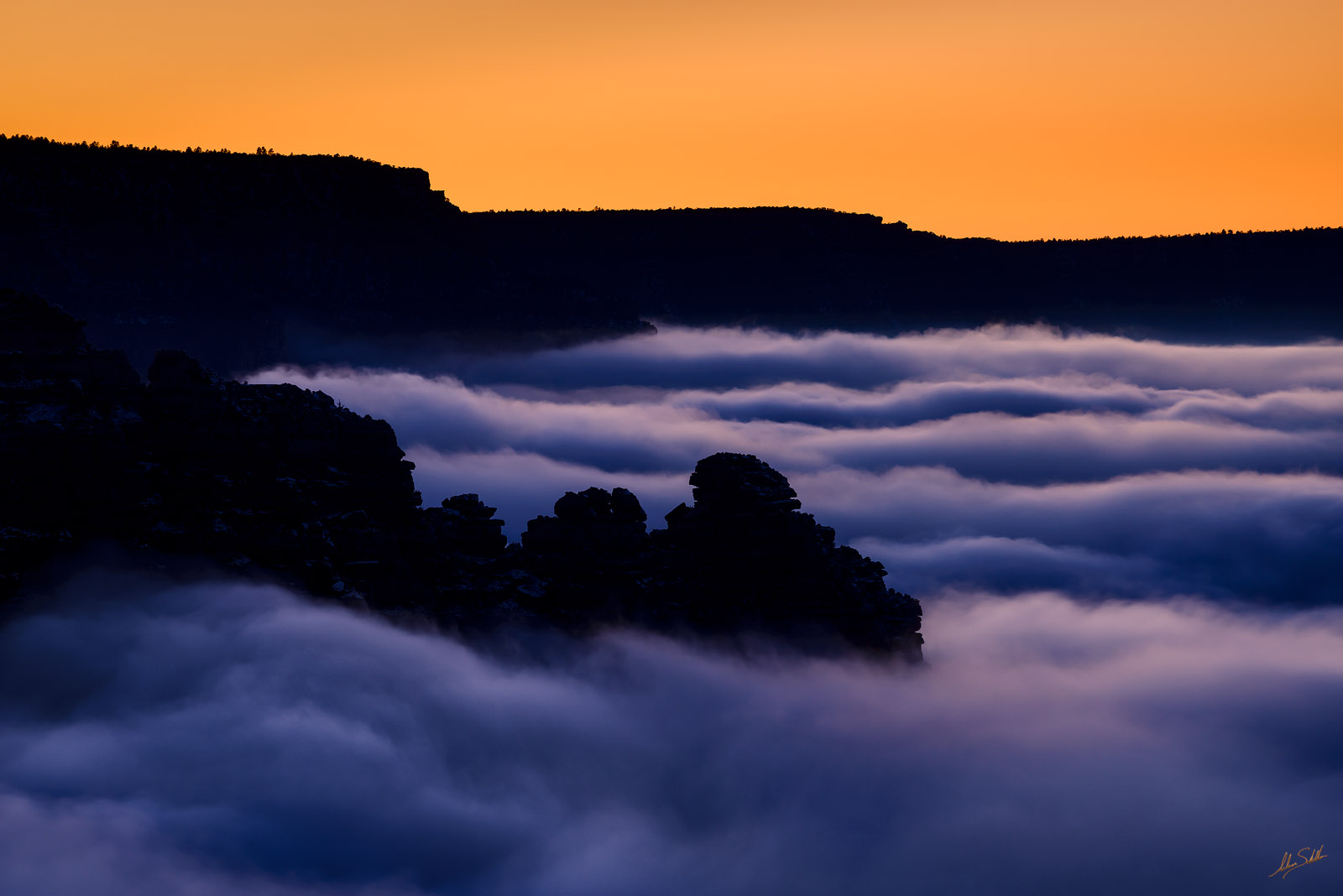 In what is known as a temperature inversion, clouds fill the Grand Canyon when cold air below the rim is trapped by warmer air...