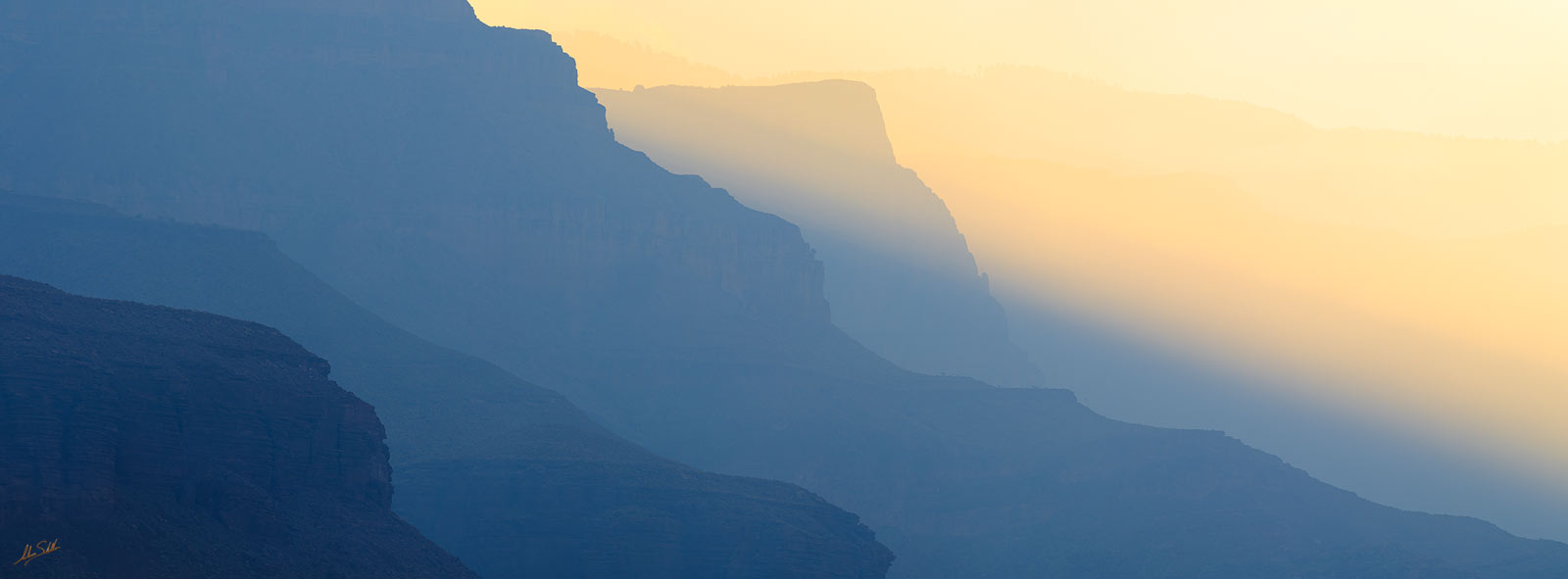 Early morning light filters through smoke from a wildfire burning on the Powell Plateau. From Owl Eyes Camp on the Colorado River...