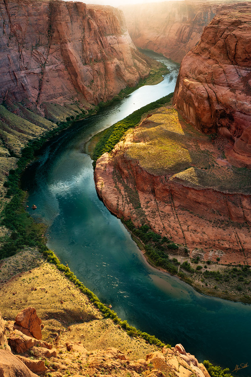 The Colorado River carves through the sandstone of northern Arizona. The river's ability to cut into the sand has lead to it...