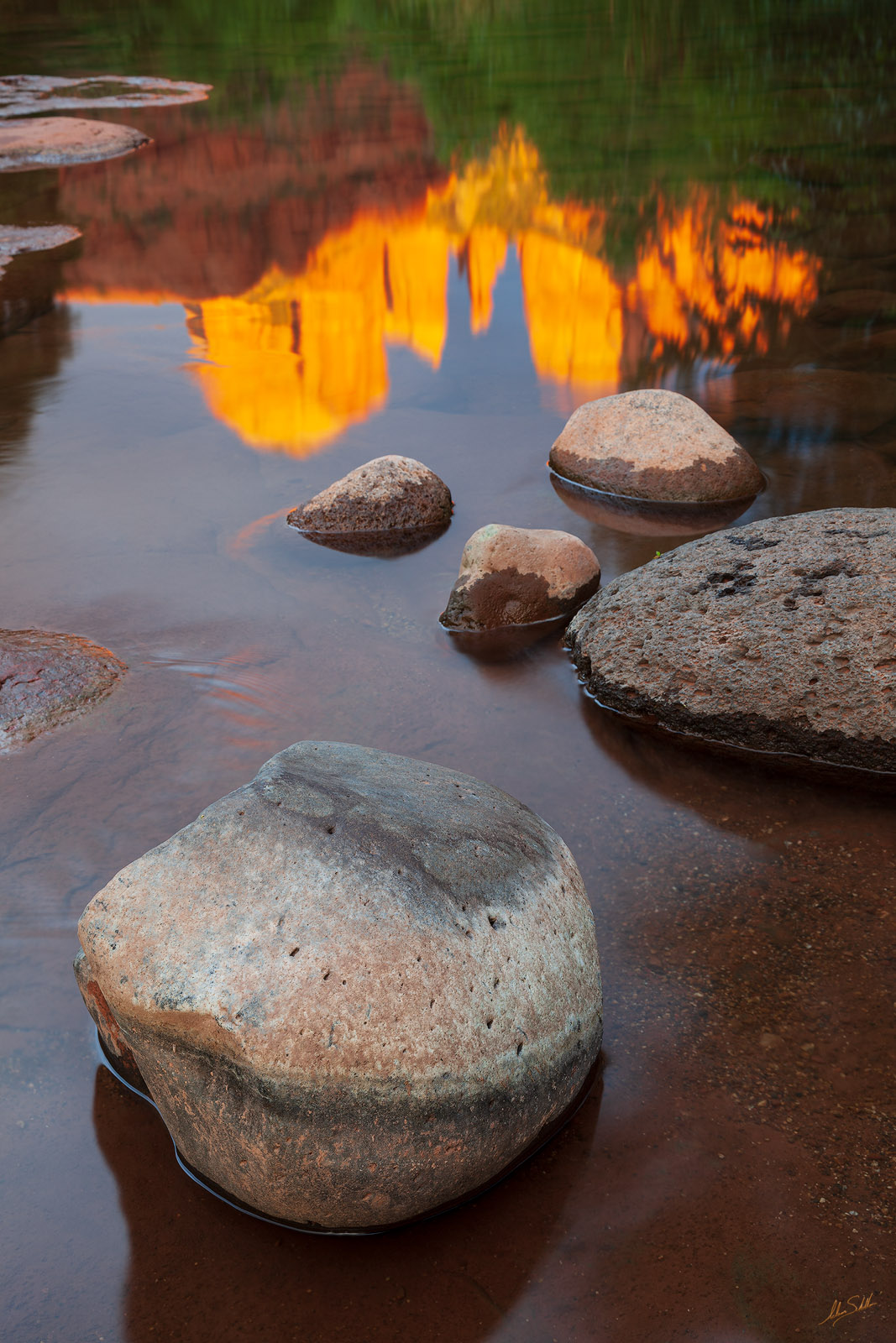 Cathedral Rock reflects in the calm waters of Oak Creek in Sedona, Arizona. © Adam Schallau, All Rights Reserved.